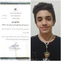 قهرمانی فرزند همکار آبفای ایلام در مسابقات فنون رده پایه کشتی آزاد استان